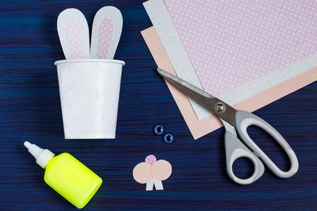 Homemade making of boxes from paper cups for sweets and candy in form of Easter hare. Present children. DIY concept. Step by step photo instructions. Step 4. Gluing rabbit ears Imagens