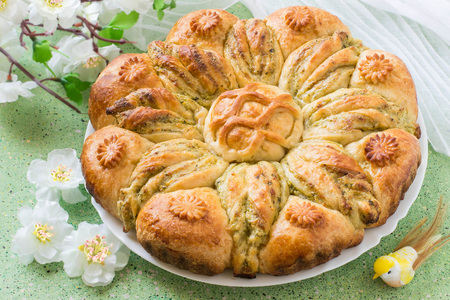 Creative homemade cake of yeast dough with stuffed of cottage cheese. The original cake in shape of flower and card for your text. Festive dessert for Mothers Day, birthday, anniversary