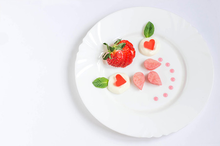 thyme: Delicate dessert for ladies with fresh strawberries, biscuit cake, cream and jelly. Gourmet food. Served on Valentines Day, Womens Day, Mothers Day