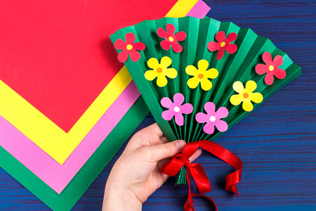 Making gift for Mothers Day by the child. Colorful bouquet of flowers out of paper. Childrens art project. DIY concept. Step-by-step photo instruction. Step 7. Final result