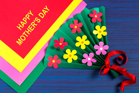 Making gift for Mother's Day by the child. Colorful bouquet of flowers out of paper. Children's art project. DIY concept. Step-by-step photo instruction. Step 7. Final result 版權商用圖片