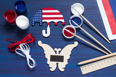 Painting souvenirs and gifts by July 4, celebration of Independence Day. Original childrens art project. DIY concept. Step-by-step photo instruction. Step 5. Gluing the magnets