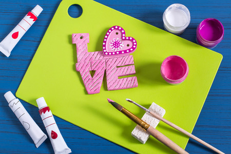 Funny crafts from salted dough to Valentines Day. Souvenirs and gifts for holiday. Art project, handmade. DIY. Step by step photo instructions. Step 12. Decoration word love