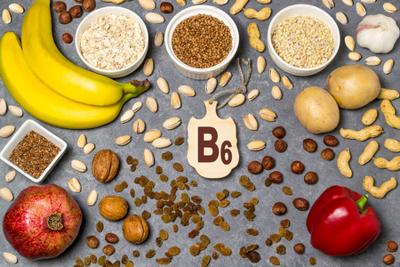 Food is source of vitamin B6. Various natural food rich in vitamins. Useful food for health and balanced diet. Prevention of avitaminosis. Small cutting board with name of vitamin B6. Top view Stock Photo - 92911945