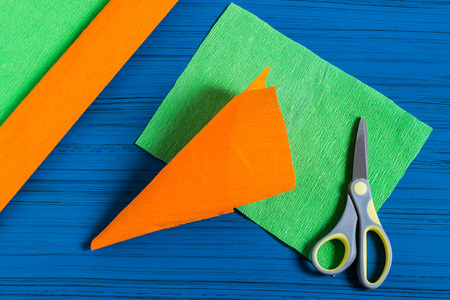 Making package in form of carrots for Easter bunny. Sweet gift to children. DIY concept. Step by step photo instructions. Step 3. Make cone of orange paper