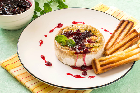 Brie cheese baked with bread crumbs and thyme. Served with cranberry sauce and grilled bread sticks