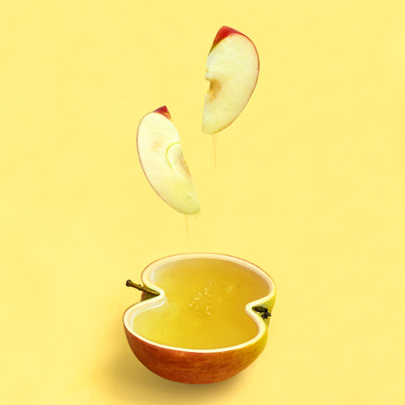 Fresh red apple as bowl for honey. Honey drips from apple slices. Apple and honey are symbols of Jewish New Year (Rosh Hashanah). Minimal style