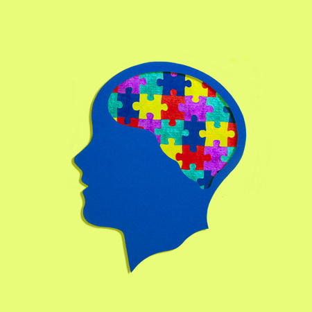 Stylized head silhouette. Multi-colored puzzles instead of brain. Symbol of autism, problems with social interaction and communication. Concept of mental health and disease Stockfoto - 114843282