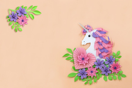 Colorful unicorn and flowers made of paper. Unicorn - symbol of magic, fulfillment of dreams. Paper art and paper craft. Invitation or holiday card for Valentine's Day, birthday and other holidays