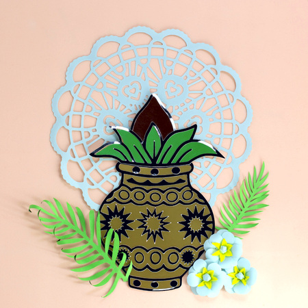 Decorative kalash with coconut and leaves, flowers and mandala. Religious festival Akshaya Tritia in India. Card made of paper. Paper art and craft. Minimal holiday concept