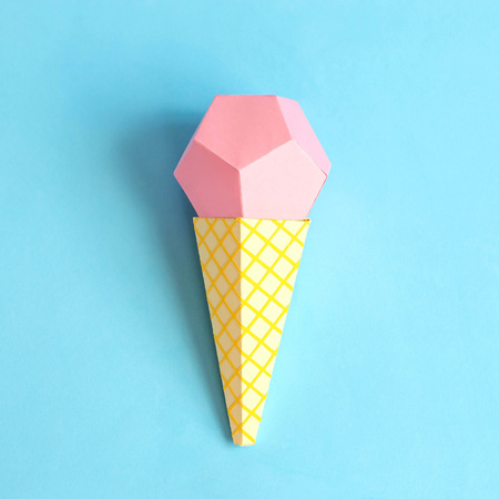 Ice cream in waffle cone made of paper. Volumetric handmade paper objects. Paper art and craft. Trendy hobby. Minimal artistic food concept. Copy space