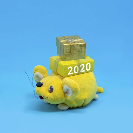 Funny toy rat carries gifts with inscription 2020. Rat is symbol of New Year 2020 in Eastern calendar. Happy Chinese New Year. Minimal style