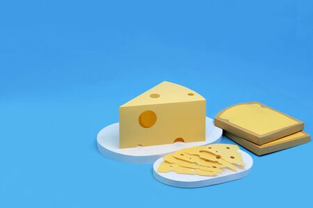 Paper toasts, triangular piece and slices of Maasdam cheese. Dairy products made from paper. Paper art and craft. Volumetric handmade paper objects. Minimal artistic food concept