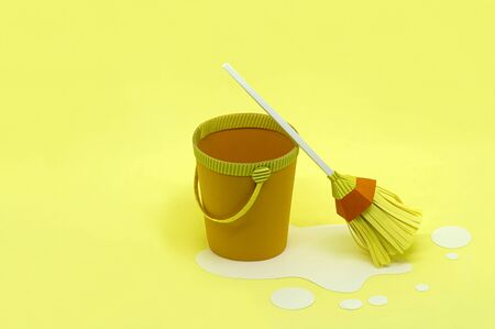Paper bucket and mop for cleaning. Spring cleaning. Paper craft and art. Real volumetric handmade paper objects. Minimal art cleaning service concept. Copy space