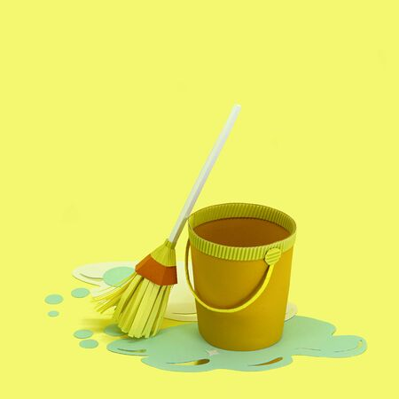 Paper bucket with spilled water and mop. Room cleaning. Paper craft and art. Real volumetric handmade paper objects. Minimal art cleaning service concept