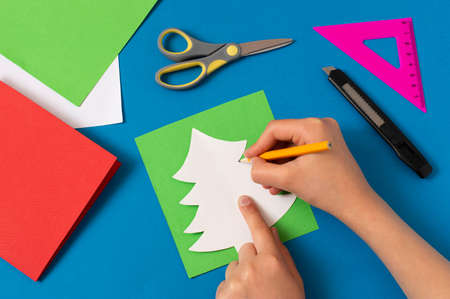 Child makes card with Christmas tree. Original children's art project. DIY concept. Step-by-step photo instructions. Step 3. Draw Christmas tree using temp