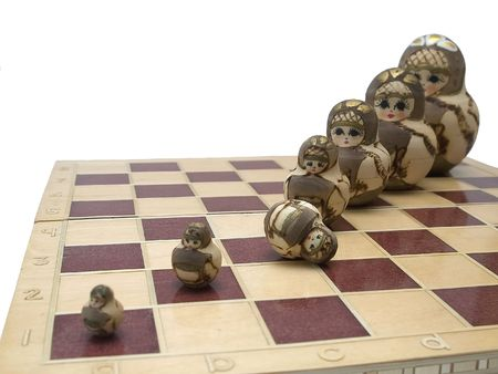 nested: out of order - nested dolls on chessboard