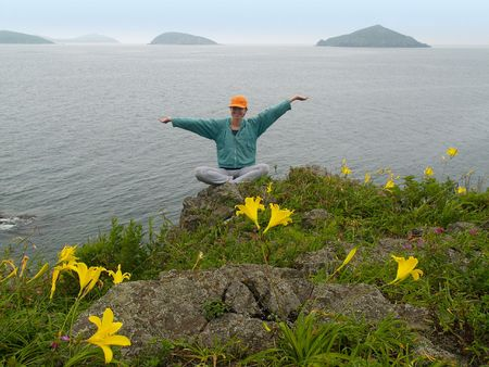 happy girl  on the rock with arms wide open Stock Photo - 937016