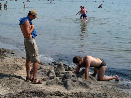 men building sand castle        Stock Photo - 948575