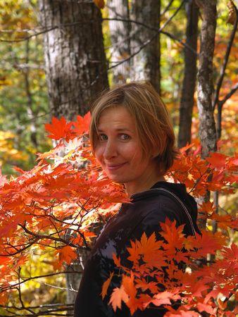 happy girl among maple leaves photo