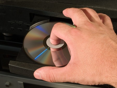 inserting dvd disk in player photo