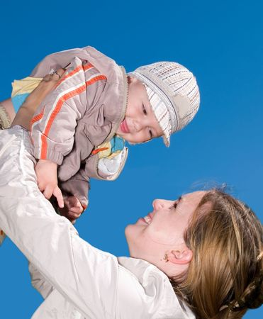 mother holding her child in the sky Stock Photo
