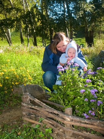 mother teaching flowers her baby Stock Photo