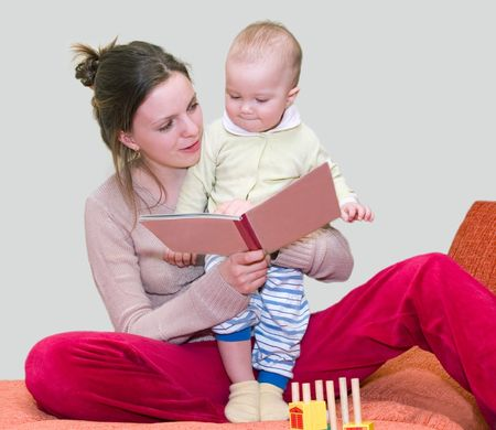 young woman reding book with kid