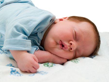 birthing: asleep baby. isolated on white