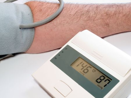high blood pressure measuring with automatic tonometer photo