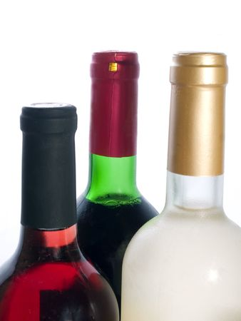 red and white wine bottles isolated photo