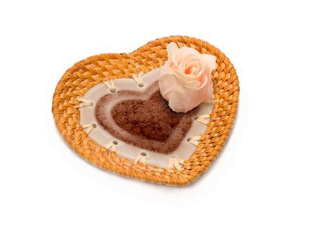 valentines day gift dish in shape of heart with artificial pink rose isolated on white photo