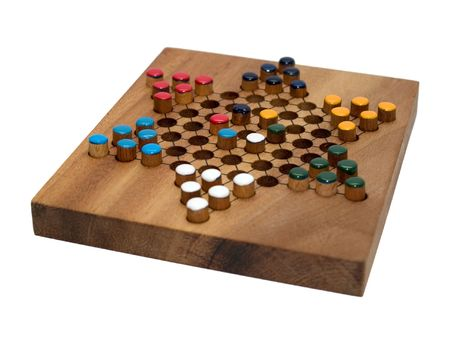 chinese checkers wooden board isolated on white photo