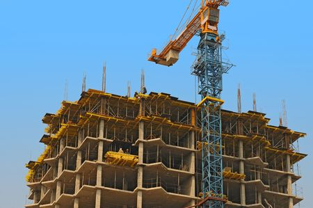 housebuilding: monolithic housebuilding and crane