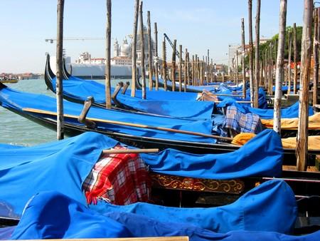 Gondolas moored at the grand canal at Venice Italy photo