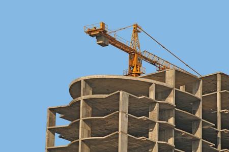 housebuilding: modern monolithic housebuilding and crane