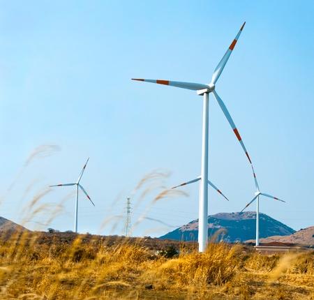 A row of turbines of windmills at Jeju Island of South Korea