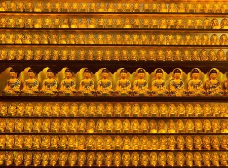 Golden buddha statues at Yakcheonsa Temple, Jeju Island, South Korea Stock Photo - 9375144