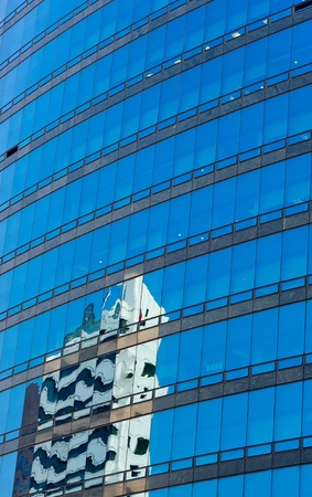 Modern glass skycraper with building  reflection Stock Photo - 9375136