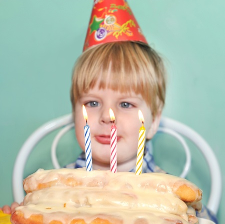 Young boy blowing birthday candles  photo
