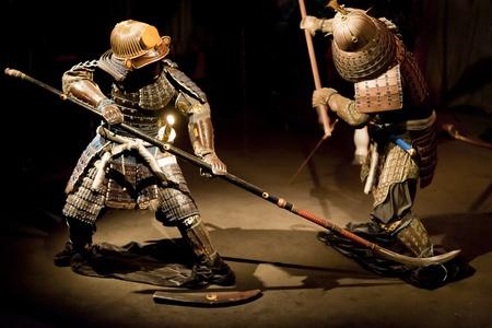 samurai warriors in reconstruction of old japanese war battle