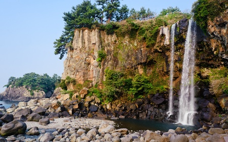 view of famous Jeongbang Waterfall on Jeju Island of South Korea