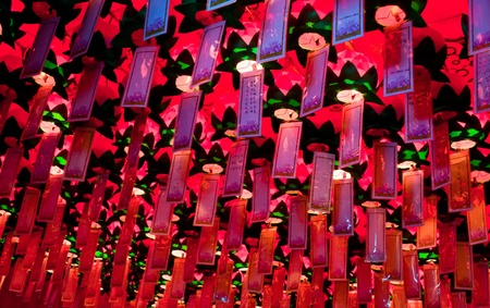 Lungta, ritual wish flags hanging inside of Buddhist Yakcheonsa Temple, Jeju Island, South Korea photo