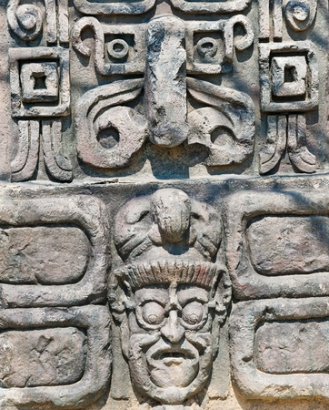 ancient aztec stone relief background photo