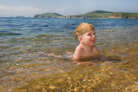 happy kid in the sea water  photo