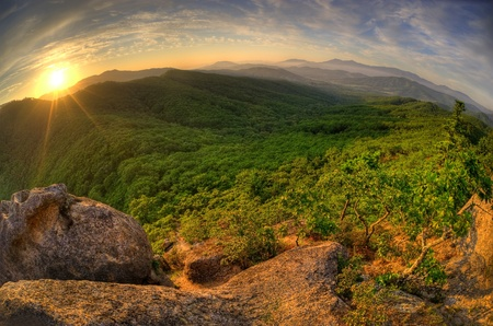hdri: Fish-eye view of majestic sunset of the Russian Primorye mountains landscape HDR image