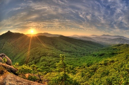 hdr: Fish-eye view of majestic sunset of the Russian Primorye mountains landscape HDR image