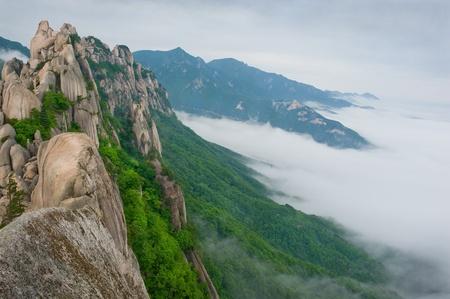 Famous Ulsanbawi Rock against the fog seorak mountains at the Seorak-san National Park, South korea  photo
