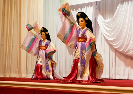 traditions: SOKCHO, KOREA - JUNE 11: Traditional Korean fan dance at dinner party of the 6th Seorak international trekking festival, June 11, 2010 in Sorakpark at Sokcho, South Korea