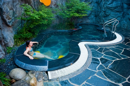 therapy geothermal: young woman at the hot thermal spa water pool of the Seorak Waterpia aquapark, Sokcho, South Korea